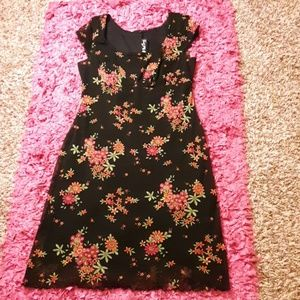 Ladies Floral dress with a frilly bottom design.